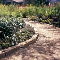 this is exactly how our garden path in Texas looked. the crushed granite feels so good underfoot