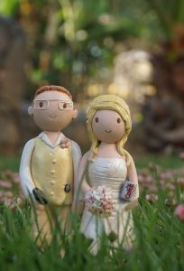 I really like these personalized toppers: http://www.wedding-cake-toppers.co.uk/