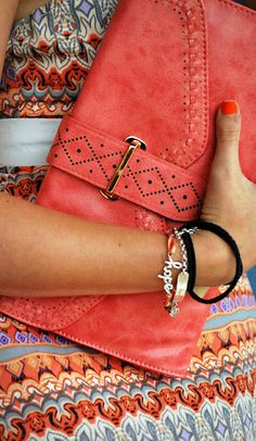 coral clutch, patterned dress, multiple bracelets. yes, yes, yes.I need this!!
