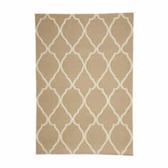 A fresh sand and ivory palette and an exaggerated scale is all it took to modernize our classic Moorish fretwork design. As a kilim, it