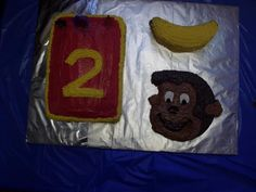 curious george themed cakes: top right is a banana, and bottom right is george!