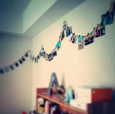 @annakim77 came up with a creative way to hang pictures on her walls - with string and clothespins! (image via Instagram)