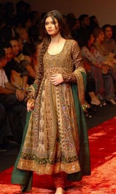 Richly sequined and beaded anarkali suit comprising long dress,  churidaar and dupatta. All the beadwork makes for a very heavy frock! I tried one on once and am amazed how a woman can wear an outfit for long without tiring. But oh, so beautiful.