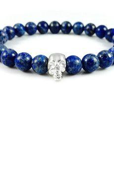 Dizarro to męska biżuteria najwyższej jakości produkowana z kamieni półszlachetnych, srebra, złota oraz kryształów Swarovski™.  Bransoletka wykonana z kamieni lapis lazuli oraz czaszki ze srebra wysokiej próby 925.Szczegóły:- czaszka zesrebra 925- bransoletka wkładana na elastycznej gumce- średnica kulek: 8 mm- bransoletka zapakowana w eleganckie, czarne pudełko