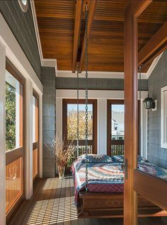 Now this is my idea of a sleeping porch! Second story, with screens.