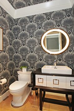 For a half bath, why not go with a bold wallpaper choice?!?