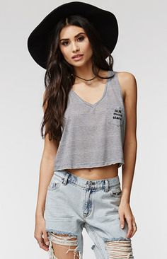 """The women'sRelaxed V-Neck Tank by Kendall & Kylie for PacSun and PacSun.com features a deep v-neckline and stripes throughout. The tank has a cropped cut and a pocket with subtleembellishment on the front. We love wearing this with our high waisted shorts and chic sandals!   17"""" length 9"""" arm openings Measured from a size small Model is wearing a small Her measurements: Height: 5'7"""" Bust: 32"""" Waist: 24"""" Hips: 34"""" 82% polyester, 18% rayon Machine washable Made in USA"""