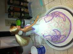 Barbie doll cake for birthday. Flower piping icing purple white pink