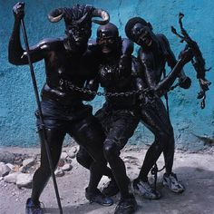 Phyllis Galembo, Three Men with Chains, Jacmel, Haiti, 2004
