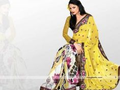 Enhance your charm wearing this saree designed with blend of off white and yellow shade. Floral printed skirt portion with embroidered pallu seems good combination. Rich border enhanced with patch border. It will look good for semi-formal parties. http://goodbells.com/saree/printed-yellow-saree-with-embroidered-pallu.html?utm_source=pinterest_medium=link_campaign=pin08AugR32P150