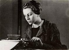 Gerda Taro at a typewriter, Paris 1936, by Fred Stein.