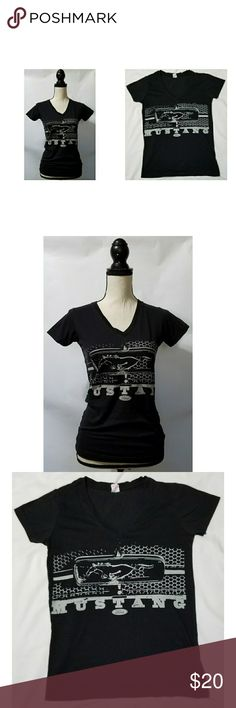 """Ford Mustang Black V-neck Graphic Logo Tshirt M Womens Ford Mustang black v-neck graphic tshirt, size medium. It is in excellent used condition with no stains, tears, rips or holes that I can see.  100% cotton   Chest: 34"""" Armpit to armpit: 17"""" Shoulder to waist: 24.5"""" Armpit to waist: 17""""  All items come from a smoke and pet free home. LAT Tops Tees - Short Sleeve"""