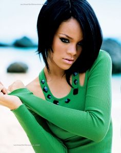 Rihanna - She is beautiful and I especially love this picture because of the beautiful green shirt, her dark hair, and the hair cut.