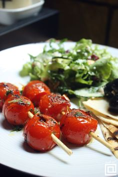 Black olives with zeytin baharat and grilled tomatoes.