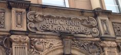 Detail over the entrance to the former Grand Assembly Rooms in Newcastle. July 2014.