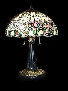 HG16231 This is a beautiful stained glass lamp made with individual hand-cut pieces of glass soldered together to make this gorgeous lamp. It is hand crafted using the same rich techniques and designs