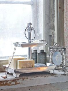 Silver works so well against white and naturals for bathroom styling.
