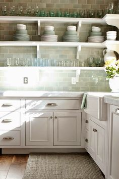 Sea glass cottage ...  Subway tile, drawer pulls & knobs with light colored counter tops...perfect for our cottage