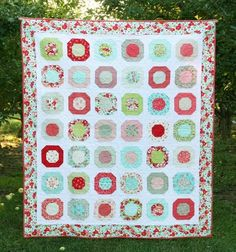 This quilt has been done for about a month and I am just now getting photos on and posted….talk about a crazy (fun!) month we've had. Plus it's been sitting in the back of my car since the Se…