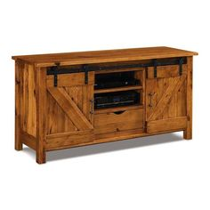 Rustic style TV stand with sliding barn cabinet doors. Cozy, warm and welcoming. Solid wood construction. Amish made in America. #TVstand Reclaimed Furniture, Amish Furniture, Wood Furniture, Rustic Barn, Rustic Style, Cabinet Space, Cabinet Doors, Unique Tv Stands, Storage Spaces