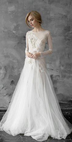 Chic tulle long-sleeve wedding dress; Featured Dress: CarouselFashion