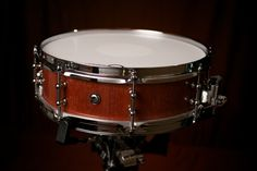 Bubinga with natural lacquer topcoat and beeswax. Tube lugs and piccolo hardware.