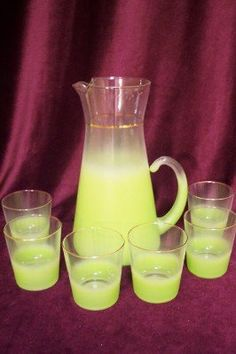 """Nice Blendo West Virginia Glass green frosted pitcher and 6 tumblers set from 1950's. Very nice condition with no chips or cracks. Measurements are for the pitcher - the glasses are 3.25"""" tall.  $50.00"""