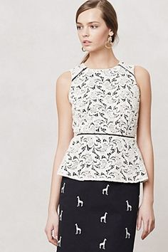 Loving the mix of classic lace peplum with a funny twist