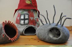 Cat bed made by German artist Dornroeschen Filzunikate. This beautiful piece of functional art called a Katzenhohle, cat cave, is handmade of soft and warm alpaca fiber mixed with merino wool.
