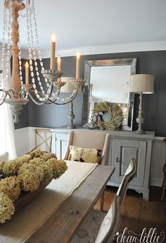 This simple wheat wreath from  is the perfect soft and subtle autumn touch to this gray dining room.