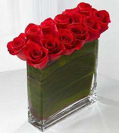 Red rose centerpiece - very clean design Red Centerpieces, Red Vases, Christmas Centerpieces, Red Rose Arrangements, Modern Flower Arrangements, Rose Bouquet Valentines, Red Rose Bouquet, Cheap Flowers, Flowers Delivered