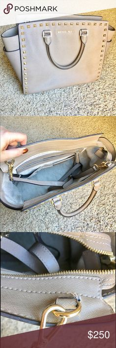 Michael Kors Selma taupe handbag A beautiful taupe bag with gold studs surrounding. Very good condition. A couple dings, as shown, one of the inside hooks has ripped a little bit due to wearing it like a crossbody when the purse is too heavy. A little leather cleaner on the back would be nice just to clean it up a bit (from rubbing against jeans), but nothing noticeable. The color of this purse is beautiful! Originally a $350 purse, asking $250 or best offer. Serious offers only please, no…