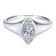 A unique ring for sure! Gabriel 14 Karat Contemporary Engagement Ring ER911941R0W44JJ for about $2,310