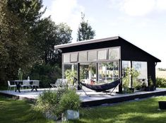 Outbuilding of the Week: Black and White Orangery, Scandi Style (Gardenista: Sourcebook for Outdoor Living) Backyard Studio, Garden Studio, Outdoor Rooms, Outdoor Living, Modern Greenhouses, Black Building, Scandi Style, Glass House, Beach Cottages