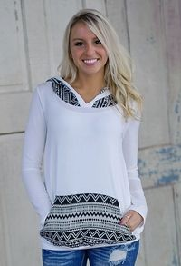 Tribal print knit hoodie with printed kangaroo pocket and hood. Ivory