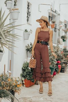 7f3e6d970b6a Dark red and nude printed ruffled jumpsuit+cognac wedges+black belt+straw  hat+hoop gold earrings+cognac leather and net handbag+gold necklace.