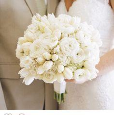 A beautiful white wedding bouquet.