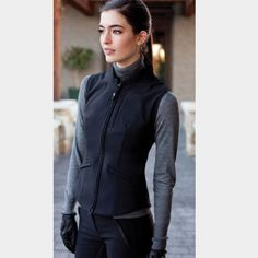Asmar Equestrian riding vest Black brand new- never worn equestrian riding vest. 3 pocket on the front and a zip opening on the back as pictured. Asmar Equestrian  Jackets & Coats Vests