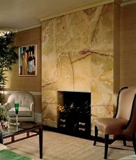 Pistachio Onyx adds warmth to this elegant living room. Fireplace Feature Wall, Cozy Fireplace, Fireplace Surrounds, Fireplace Design, Fireplace Mantels, Fireplace Ideas, Onyx Tile, Marble Fireplaces, Stone Fireplaces
