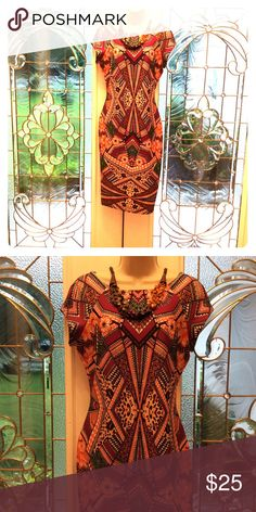 Tribal Bodycon Beautiful printed dress will accentuate your curves. Great dress for a night on the town. Indication Dresses