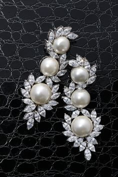 This is a sensationally striking pair of #DiosabyDarshanDave #earrings, with a strong design aesthetic. They feature marquise-shaped #SwarovskiZirconia curving effortlessly around white Korean pearls forming a breathtaking silhouette. Ideal for #travel and #destinationweddings! #makeeverydaybrilliant #jewellery #finejewellery#traveljewellery #weddings #fashionwear#preciousjewellery #luxejewellery #dailywear#workwear #casualwear #destinationweddings #bridalwear #womansnewbestfriend