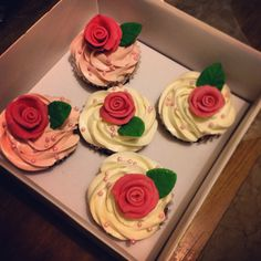 Vanilla cupcakes with vanilla Swiss meringue buttercream and fondant roses and leaves.