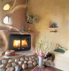 I like the organic feel of this fireplace and built in shelves.