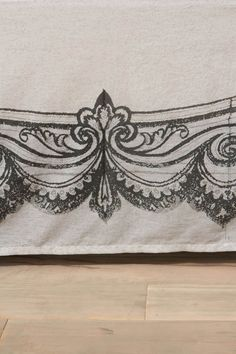 bedskirt...stenciled rather ornate but basic idea