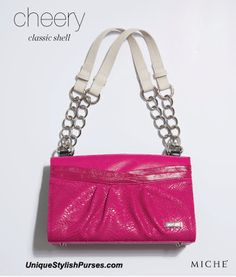 Her name speaks volumes. The Cheery Shell for Classic #Miche Bags can't help lifting your spirits when you slip her on.  Bright fuchsia snake-print faux leather kissed with a high-gloss finish features enchanting details like piping and pleats in all the right places. She's feminine through and through—so get Cheery! #purses #miche