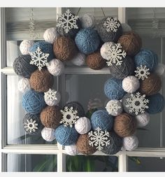 DIY yarn ball Christmas winter wreath made by Tyler Reiniche