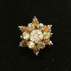 Vintage brooch Six point star brooch with gold pale green and aurora borealis rhinestones. Brilliant sparkle. Jewelry Brooches