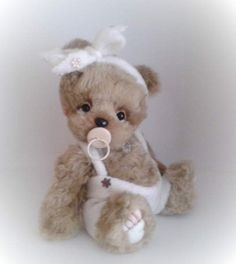 Mates By zorkabears - Mates is hand-sewn teddy bear. He measured 30 cm (12 in) standing. The body has five joints. He is filled with hollow fiber and natural granulate. The eyes are glass. He is made of faux fur.