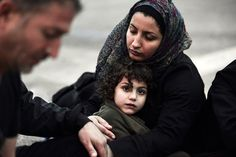 """letswakeupworld: """" A Syrian mother tries to warm up her daughter after arriving on the Greek Island of Lesbos."""