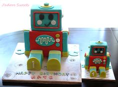 3D Cakes - 3D Robot Cake made with chocolate mud cake and filled with chocolate ganache. The mini robot cake was the little boy's smash cake and his reaction was priceless!